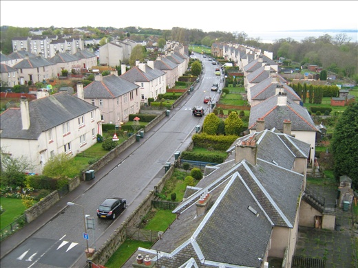 Houses along the curve of Coastal Road below both Forth Road & Railway bridges
