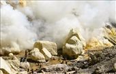 Kawah Ijen Indonesia: The dwarfed figure of a miner  suddenly emerges from an otherworldly site amidst powdery yellow sulfur rock formations, clouds of fuming toxic sulfur dioxide gases and the deafening hiss of an active gas vent.: by walidrsd, Views[27151]