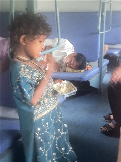 During a long Indian train ride we witnessed some of the poor children feeding off leftovers - India the place of contrast.