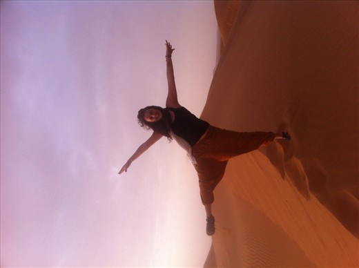 Balancing my dream on a dune in the Dubai desert
