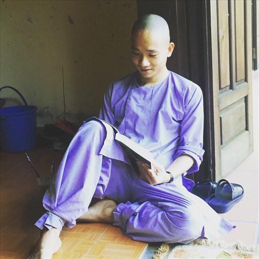 Monk in training doing his morning reading near Monikas house
