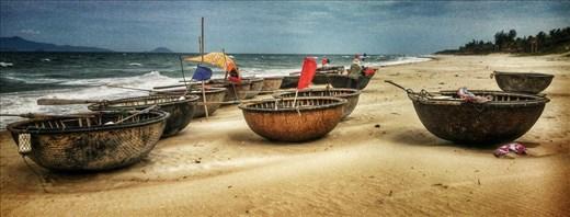 Round boats on the beach at An Bang