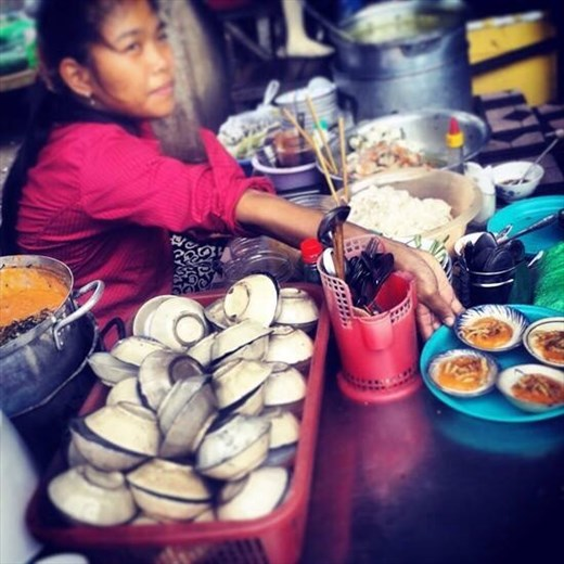 Lady selling clams
