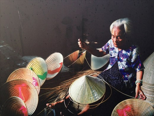 Lady making conical hats