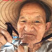 Old lady on ferry filling her tobacco pipe. : by wendyandkevin, Views[158]