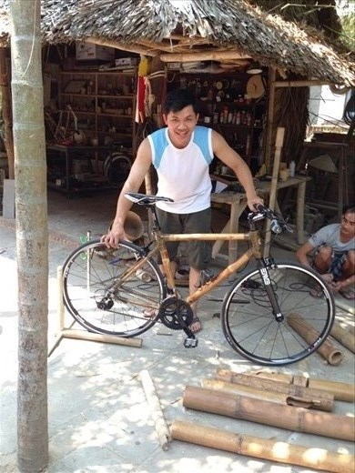Tan Vo with Kevin's bamboo bike