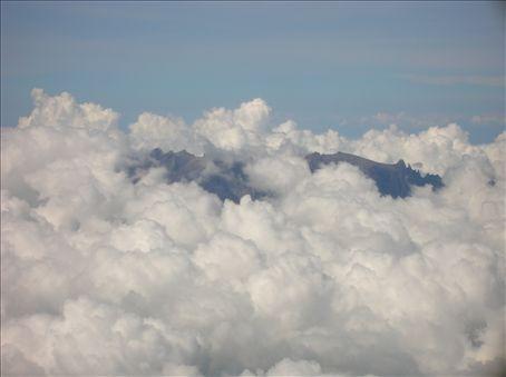 Low's peak in a blanket of clouds.