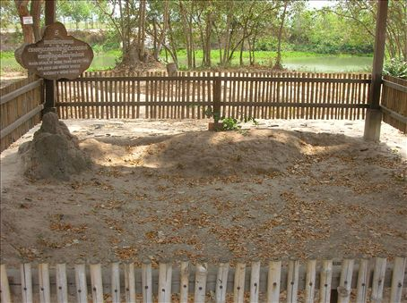Mass grave of naked women and children.