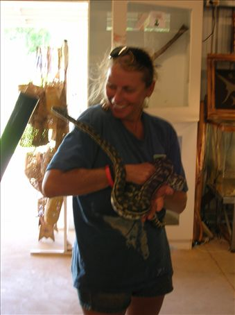 Sue and cuddles the python.