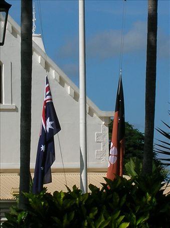 Flags at half staff.