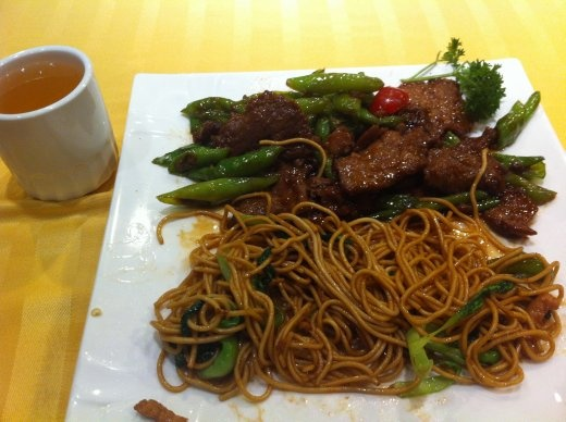 At a Chinese restaurant.  Hot pepper beef with sauteed noodles with vegetables.  Not bad, but soo oily.