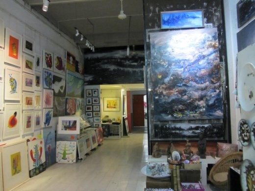 Unfortunately no picture of the back of the studio.  Artist talked about his work that portrayed children with open mouths and water faucets indicating the lack of clean drinking water in China.