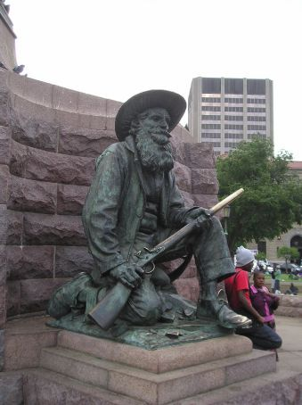 A Boer famer at the base of the Paul Kruger statue, Church Square, Pretoria.