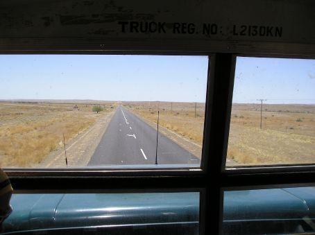 The road ahead, looking through the front window of the truck.