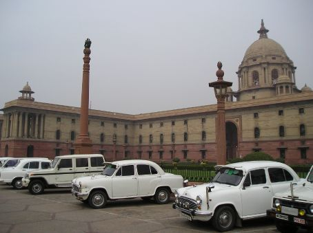 Goverment Buildings in New Delhi, the Ambassador cars in front are for ministers and civil servants. Based on the 1948 Morris Oxford design they are still made in India.