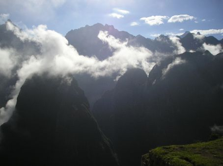The setting of Machu Picchu is perhaps it's most stunning aspect. It sits on a ridge with deep valleys on each side and surrounded by forest covered mountains.