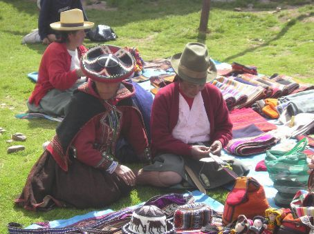 Two ladies weaving more items for the tourists.