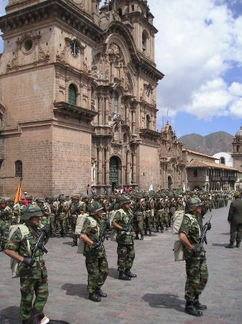 The Army marching past one of the churches in Cuscos main square.