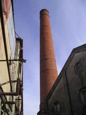 The smoke stack of the factory is a familiar landmark in the area.