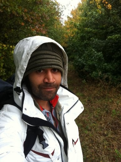 Trudging through the rain, looking for a place to set up camp. Brrr.