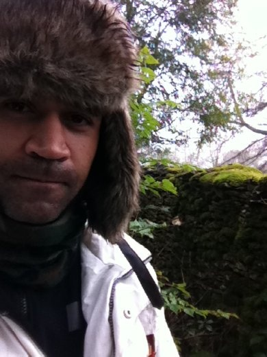 Me. Next to a wall. I like my walls how I like my women. Covered in moss.