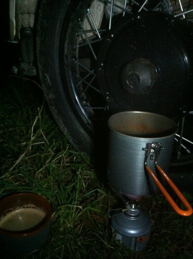 Camping wild in Scotland, making some chow to chow on. Tomato pasta, with bread and cheese and cherry tomatoes, and coffee to finish. Pretty yum. Ugh, I'm so hungry nao!