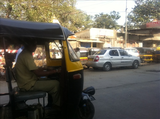 A rickshaw, or tuk-tuk, there's millions of 'em. Every man and his cow has one.