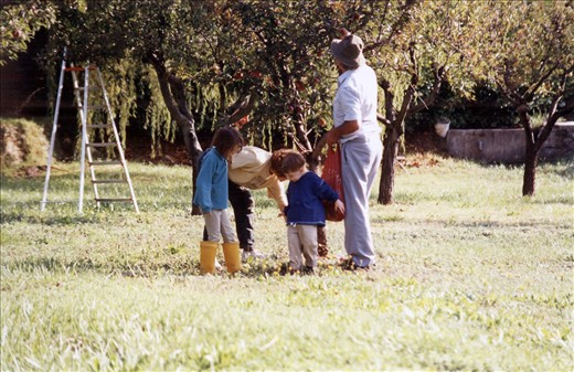Picking fresh fruit at the farmhouse in 1995 with my brother and grandparents