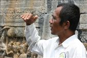 The guide will help you to understand the history of Borobudur temple. He tells of relief on the wall. (Borobudur, Magelang, Central Java): by yes, Views[241]