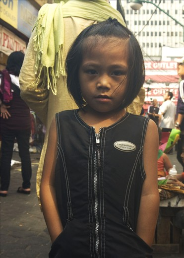 Casting a shadow of darkness upon men's children. (Quiapo, Manila, Philippines)