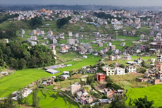 the view of houses and farms in Pokhara city