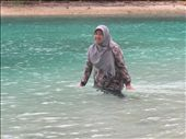 My friend, Indah, playing with the beautiful green-blue sea water in Air Island: by yoyoisjojo, Views[341]