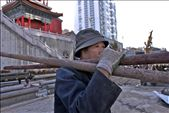 Migrant workers leave their families behind to find work in the city. This man's face appears to be painted with emotion as he looks out beyond. Perhaps he is lonely and missing his family, or feeling emptiness from monotonous work.: by yuguantemple-china, Views[139]