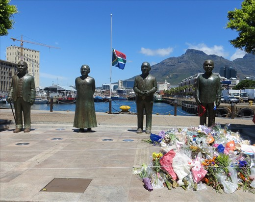 Flag at half mast and flowers at the V&A Waterfront in Cape Town in tribute to Nelson Mandela.