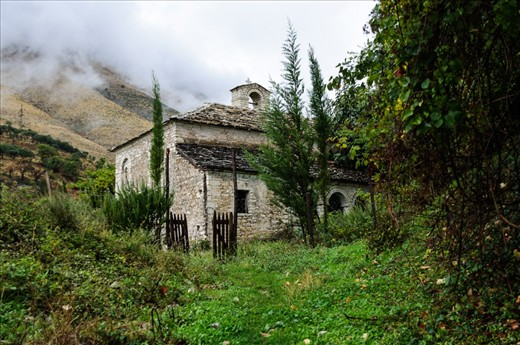Abandoned orthodox church in a village in the mountains of South Albania.  Times have changed, people have been leaving traditional villages and lifestyle to  work in cities and other neighbouring countries hoping for better income.