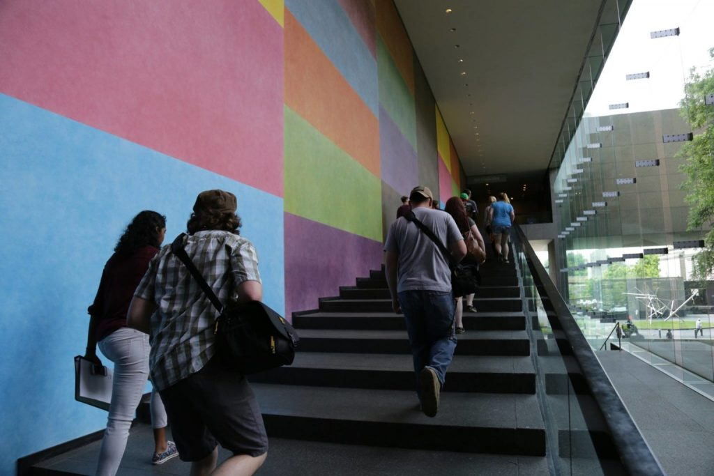 Youth interns pass Sol LeWitt's Wall Drawing 493 and Wall Drawing 450 on their way to the galleries at Carnegie Museum of Art. (Appalachian Media Institute)