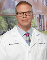 Thomas Sloane. Guy, MD