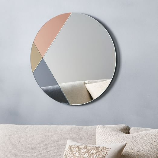 pink round glass mirror