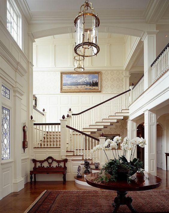 Gorgeous large staircase and traditional molding