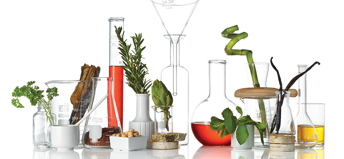 botanicals and beakers, a mixture of science and natural ingredients