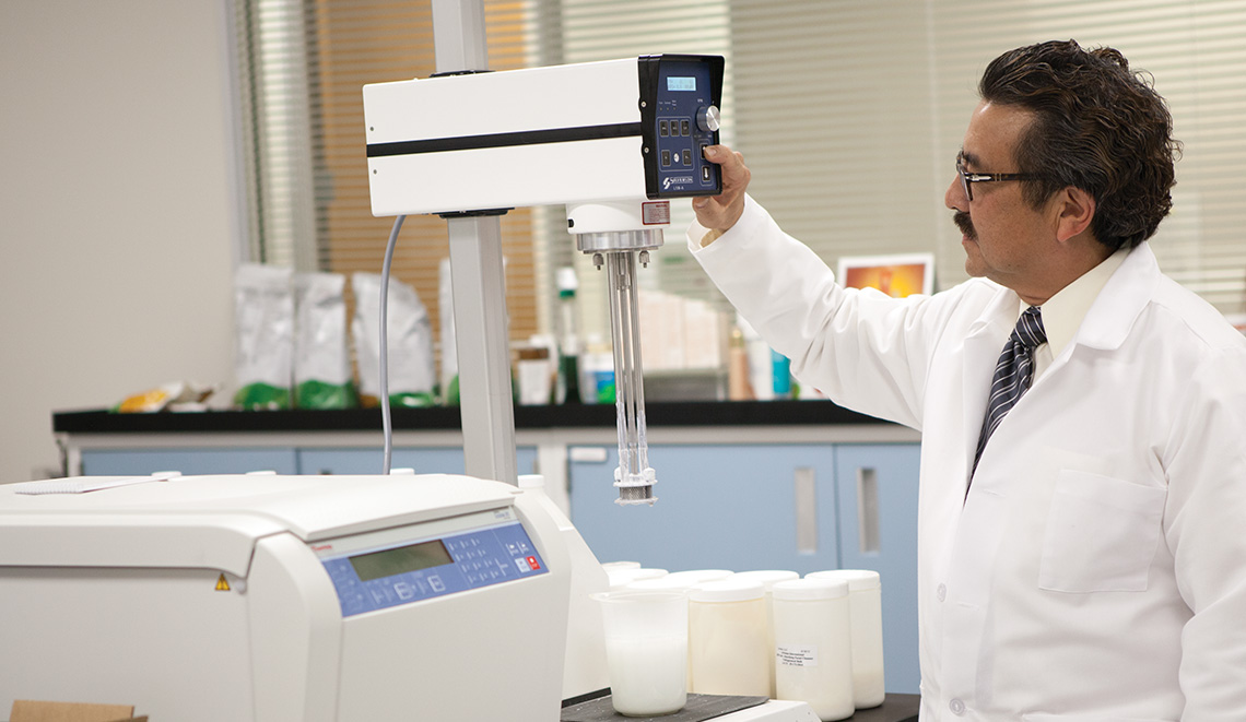 Dr. Peter Matravers working in Arbonne's Research and Development Laboratories