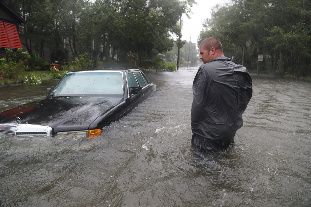 Nick Lomasney walks through heavy wind and a flooded street as Hurricane Matthew passes through the area on October 7, 2016 in St Augustine, Florida. Florida, Georgia, South Carolina and North Carolina all declared a state of emergency in preparation of Hurricane Matthew. (Photo by Joe Raedle/Getty Images)