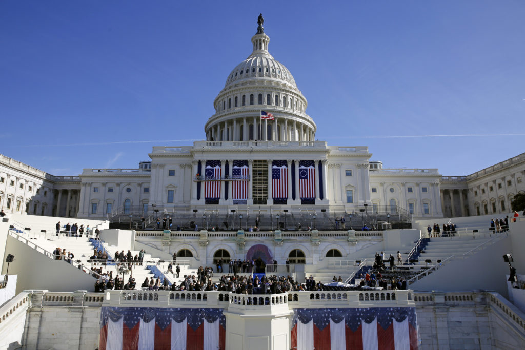 In this Jan. 15, 2016, photo, the U.S. Capitol frames the backdrop over the stage during a rehearsal of President-elect Donald Trump's swearing-in ceremony in Washington. (AP Photo/Patrick Semansky)