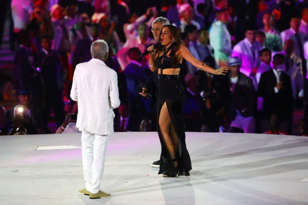 RIO DE JANEIRO, BRAZIL - AUGUST 05: Singers Gilberto Gil, Anitta and Caetano Veloso perform during the Opening Ceremony of the Rio 2016 Olympic Games at Maracana Stadium on August 5, 2016 in Rio de Janeiro, Brazil. (Photo by Elsa/Getty Images)