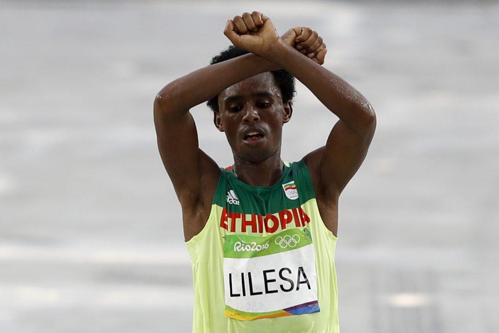 Ethiopia's Feyisa Lilesa. AFP PHOTO / Adrian Dennis / Getty Images
