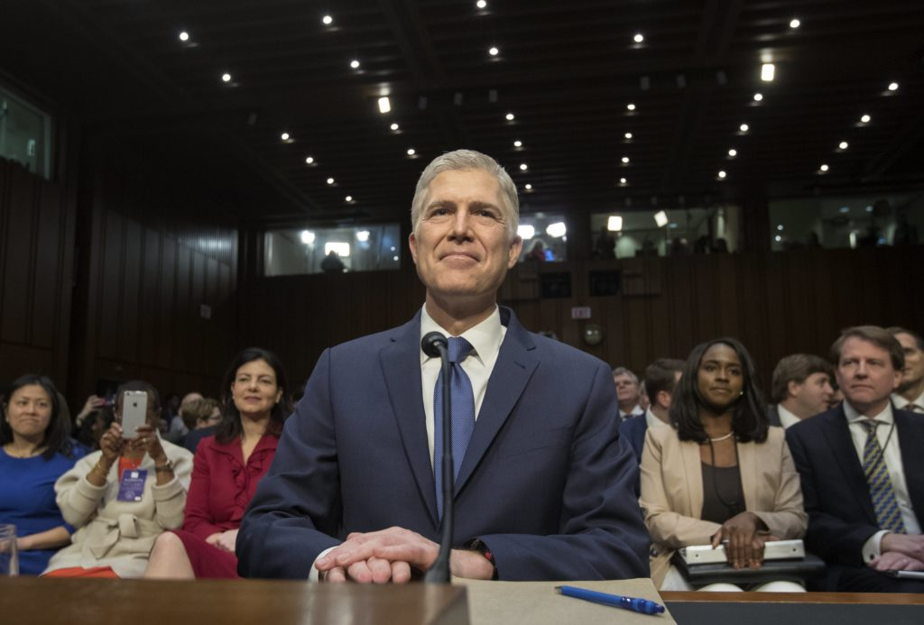 epa05860192 Neil Gorsuch appears before the Senate Judiciary Committee hearing on his nomination to be an associate justice of the Supreme Court, on Capitol Hill in Washington, DC, USA, 20 March 2017. Gorsuch, who was nominated by US President Donald J. Trump on 31 January 2017, begins his confirmation hearing 401 days after the death of Justice Antonin Scalia. Senate Republicans refused to vote or hold confirmation hearings on former President Barack Obama's nomination of Judge Merrick Garland, resulting in the longest opening on the court since the 1860s. EPA/MICHAEL REYNOLDS