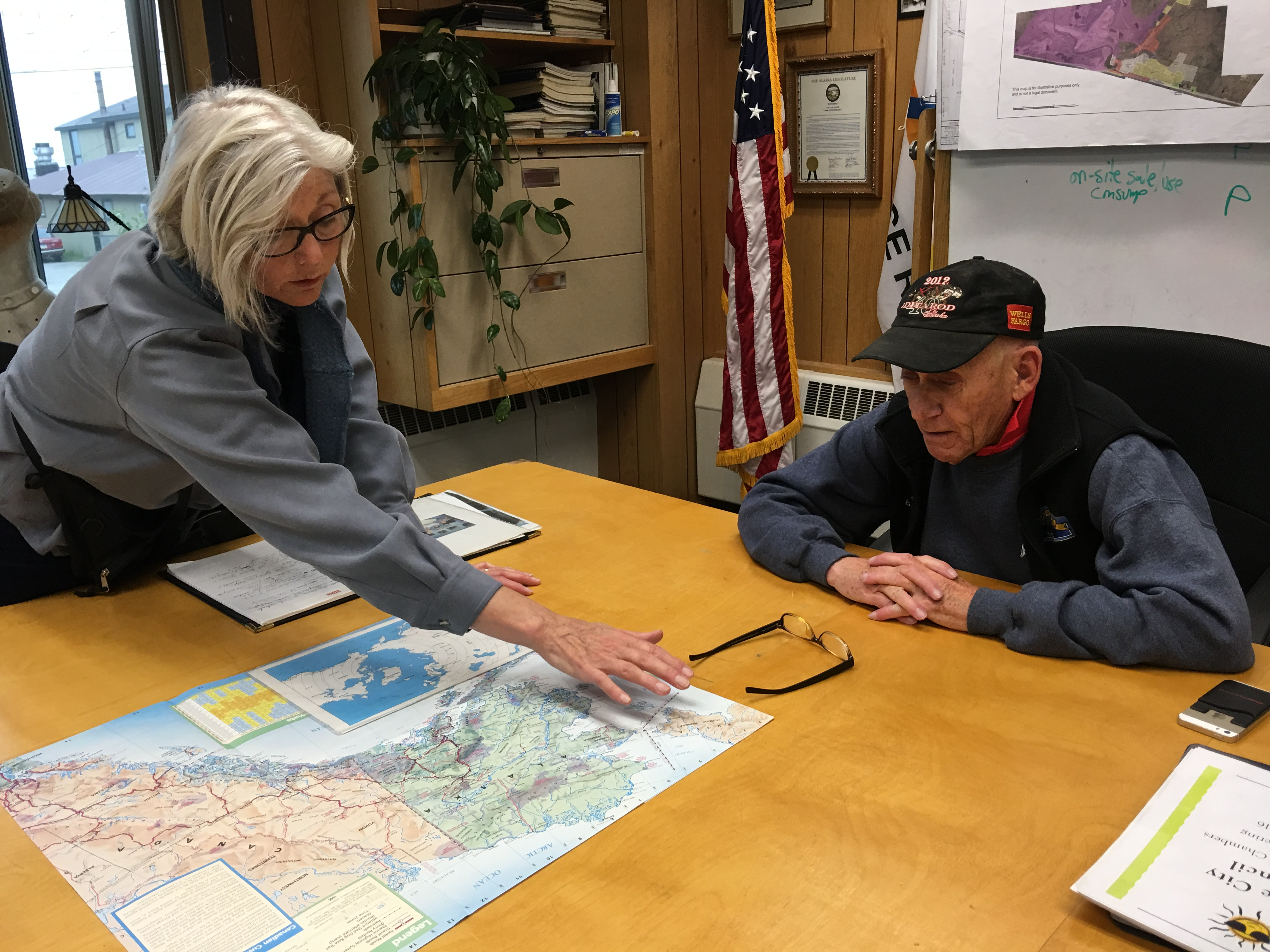 On the day before a 2016 mid-summer expedition to Chukotka, Russia, Tandy Wallack of Circumpolar Expeditions discusses the Diomede Island Family Reunion with Nome Mayor Richard Beneville. Both spoke about the need for closer relations across the Bering Strait. (Kirsten Swann / Alaska Dispatch News)