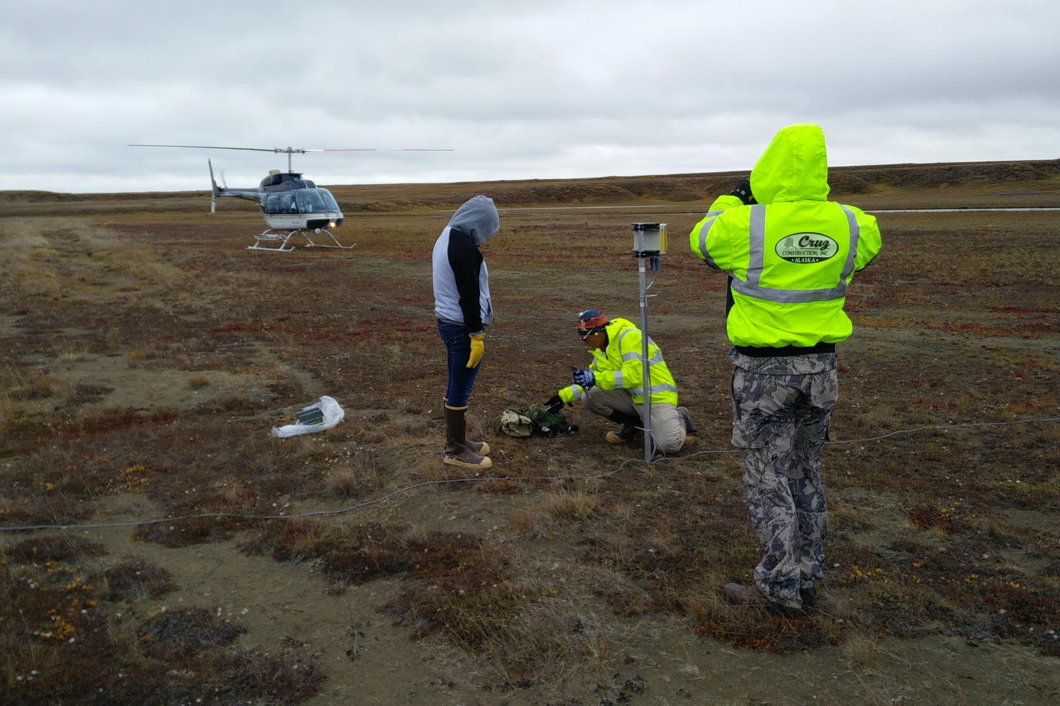BeadedStream and Cruz Construction field technicians install tundra temperature monitoring equipment along the way to Smith Bay (Paul Harren)