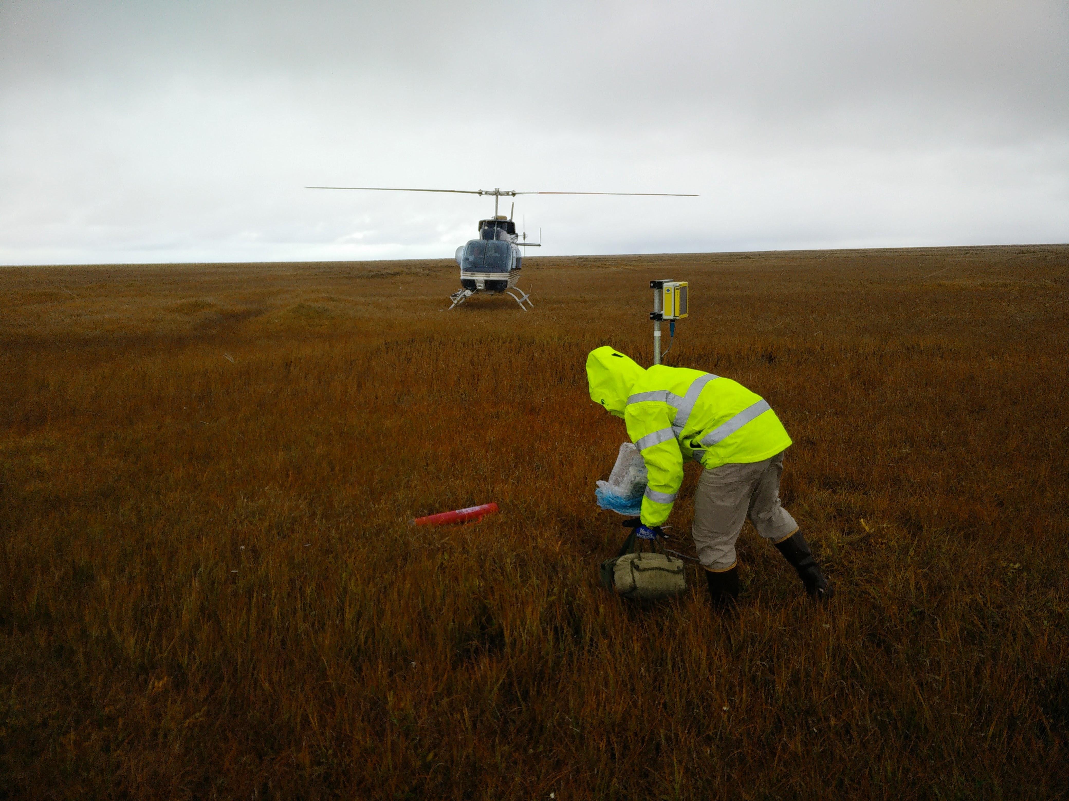 BeadedStream field lead Brian Shumaker installs tundra temperature monitoring equipment along the way to Smith Bay. (Paul Harren)