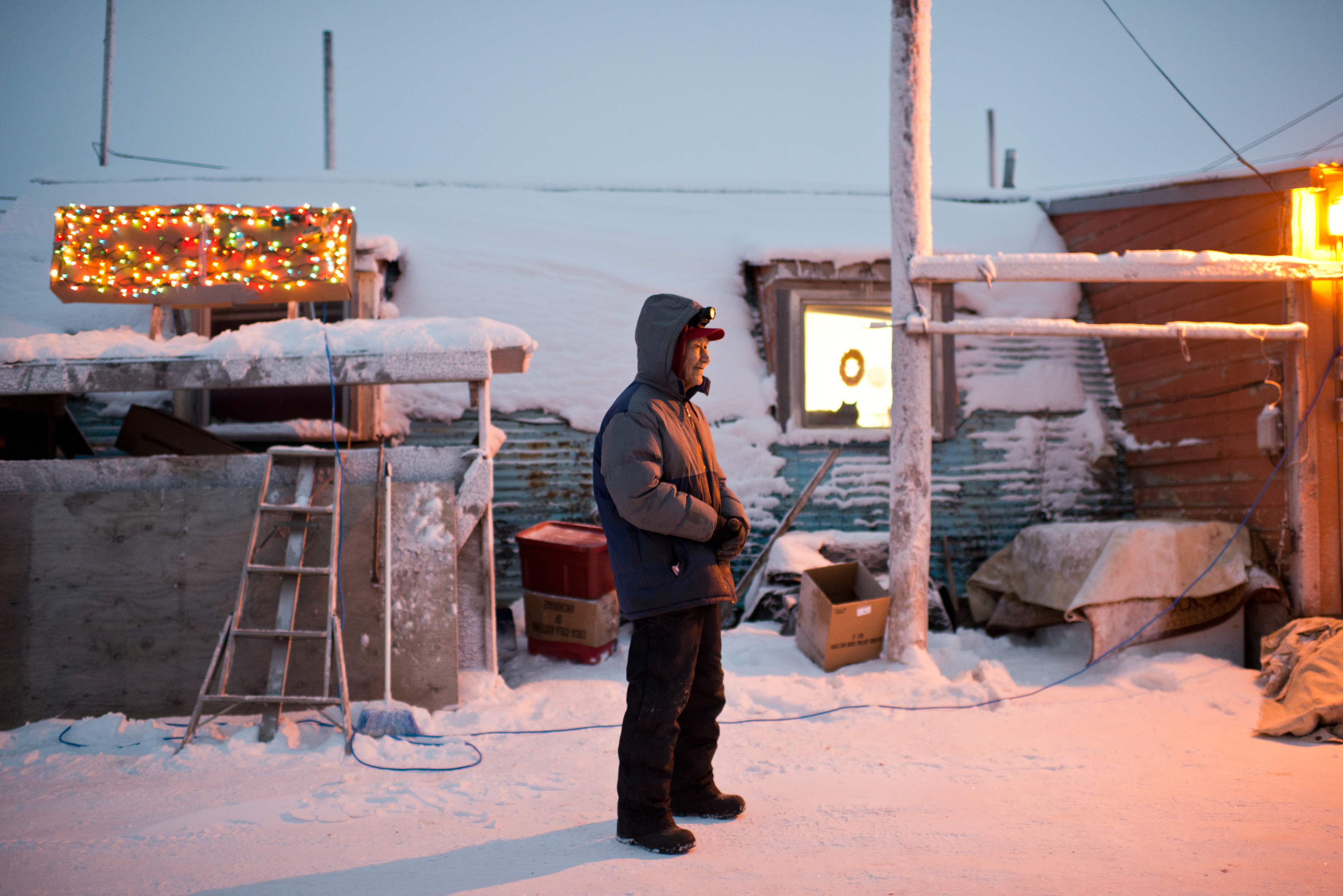 """Abel Akpik, standing outside his Quonset hut home, said he opposes the name change for his home city. """"You say you are from Barrow and they all know exactly where you are from,"""" Akpik said. Voters approved changing the name of the city of Barrow to Utqiaġvik in October, a change which went into effect on December 1. In Alaska's northernmost city, however, residents remain divided about whether they name should've changed at all, whether the process was hurried, and whether the Utqiagvik is even the proper Inupiaq place name. Photographed on Monday, December 12, 2016. (Marc Lester / Alaska Dispatch News)"""
